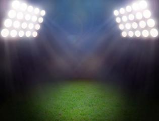 Wall Mural - Green soccer field, bright spotlights