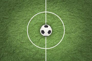 Wall Mural - Soccer ball on green field.