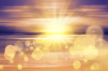 Sea sunset with bright sun and bokeh lights