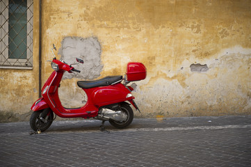 Bright shiny red Vespa scooter