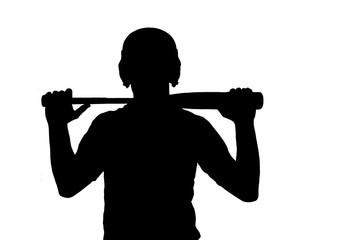 Silhouette of young baseball player holding his bat