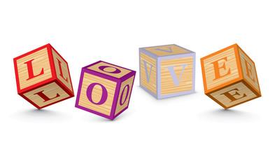 Word LOVE written with alphabet blocks