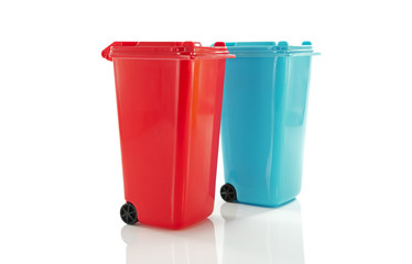 red and blue  garbage bin