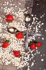 Strawberries with oatmeal and vintage spoons,