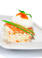 Salad with boiled vegetable, spicy salmon and egg on plate,