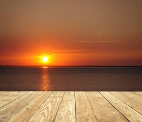 Fototapete - Sonnenuntergang mit Holz