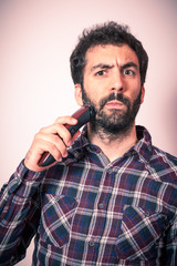 young man with strage expression when cut his beard and moustach