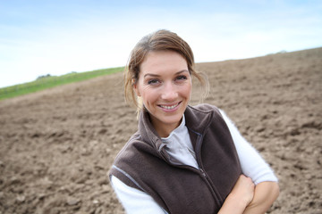 Farmer woman standing on farming land