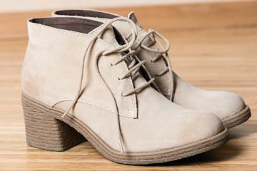 women shoes on wooden floor macro
