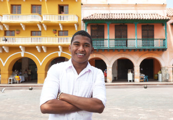 Young guy with crossed arms in a colonial town