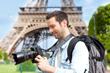 Young attractive tourist taking pictures in Paris
