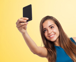 portrait of pretty young girl taking a photo her-self