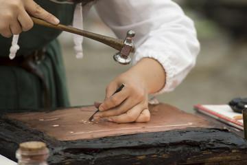 hands working copper