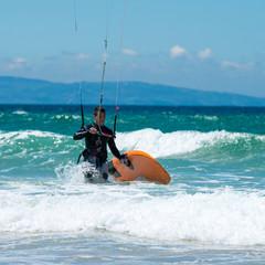 Kite surfing on a pristine beach