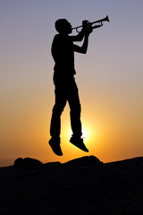 Jumping trumpet player