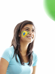 girl with brazilian flag face paint