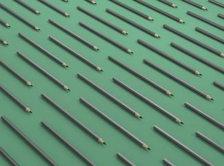 Bleistifte in einer Reihe Hintergrund grün