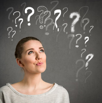 Young woman thinking with question marks over head