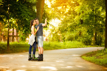 love young couple on rollerblades