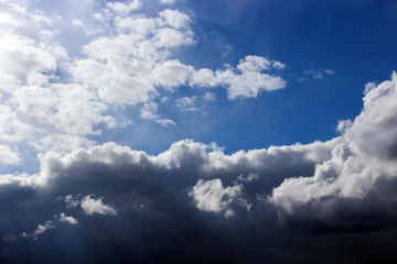 picturesque white clouds on blue sky background