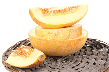 Ripe melons on wicker cradle isolated on white