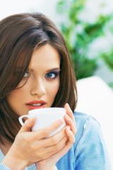 Woman coffee drink portrait.