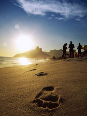 Footprints on the Shore of Ipanema Beach at Sunset