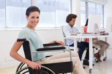 Smiling businesswoman with disabilitity