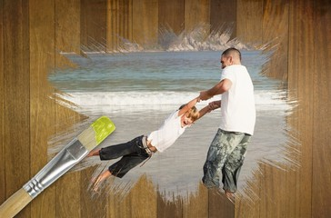 Composite image of father and son on the beach