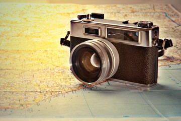 Old photo camera on world map