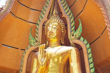 Big golden Buddha in Wat Tham Suea,Kanchanaburi, Thailand.
