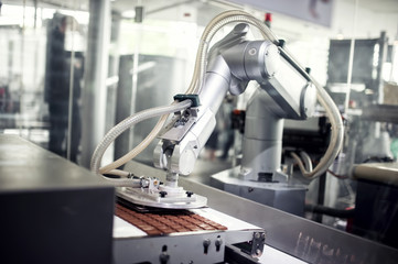 Chocolate production line in industrial factory. Automation