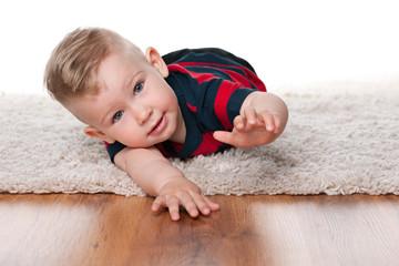 Cute infant boy on the carpet