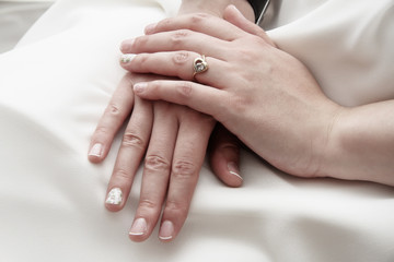 bride, hands folded in her lap