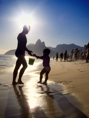 Silhouettes of Brazilian Father and Child Ipanema Beach Sunset