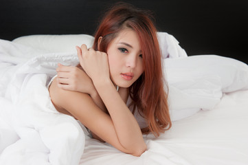 Crying woman on bed