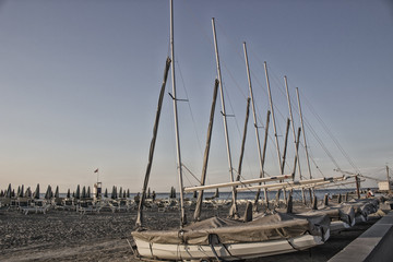 bathhouse and sailing boats on the seaside