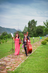 Musicians before speaking at the nature