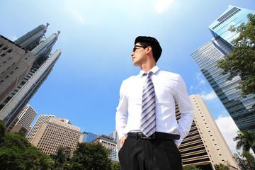 business man looking away to sky