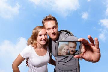 happy couple selfie by smart phone