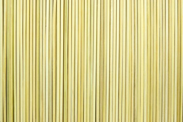 the abstract textured background of yellow color