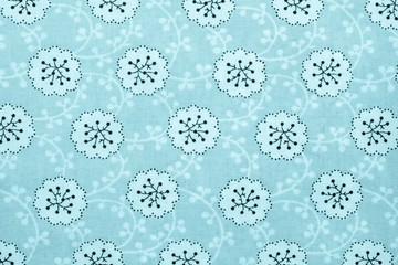 textured background of cotton fabric blue color