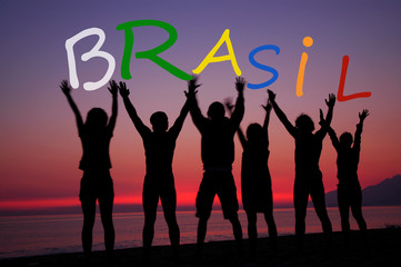 Brasil, fans holding letters on the beach
