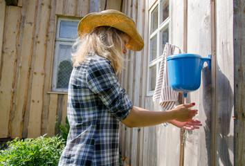 farmer woman wash hands rural plastic washer tool