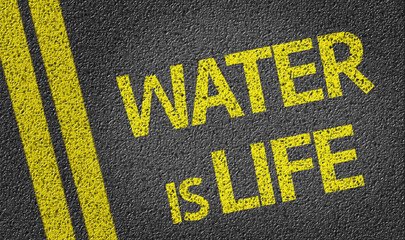 Water is Life written on the road