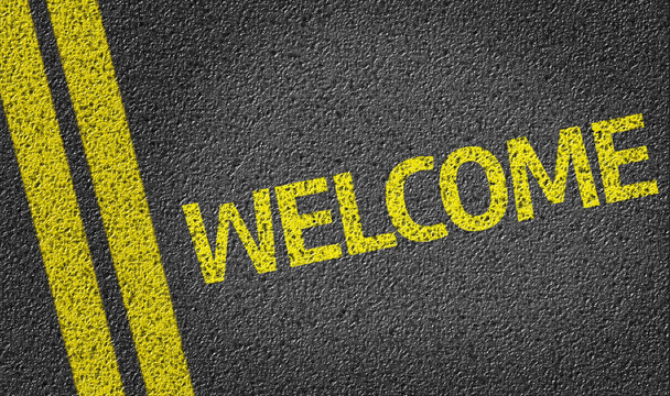 Welcome written on the road
