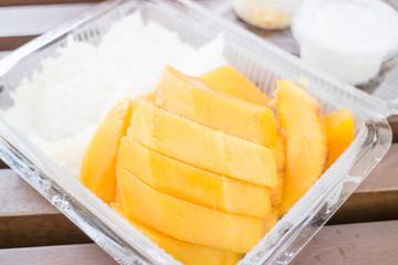 Close up dessert box of sweet mango and sticky rice