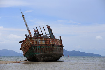 Abandoned ship with blue sky