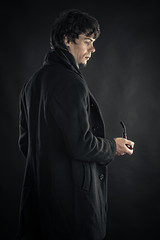 a young man in the image of Sherlock