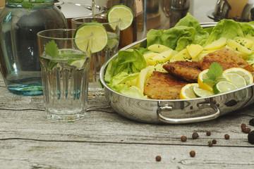 fresh pork steak with potatoes and mojito drinks